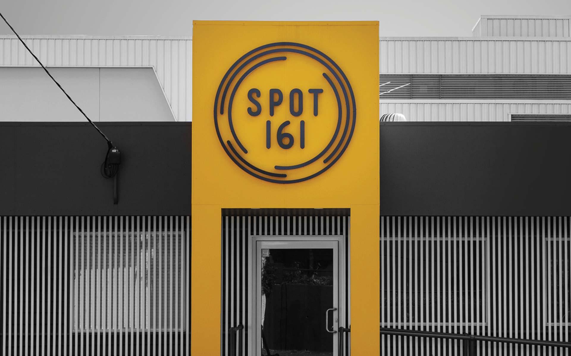 spot 161 signage design building graphics design bright yellow. Black Bedroom Furniture Sets. Home Design Ideas